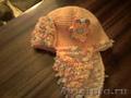 вязаную шапку-ушанку